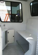 Interior of a Surveyor Junior showing Bench Seat and Corner Cabinet